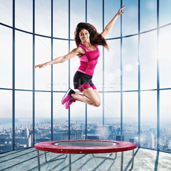 Fitness leraar springen moderne gymnasium trampoline Stockfoto © alphaspirit