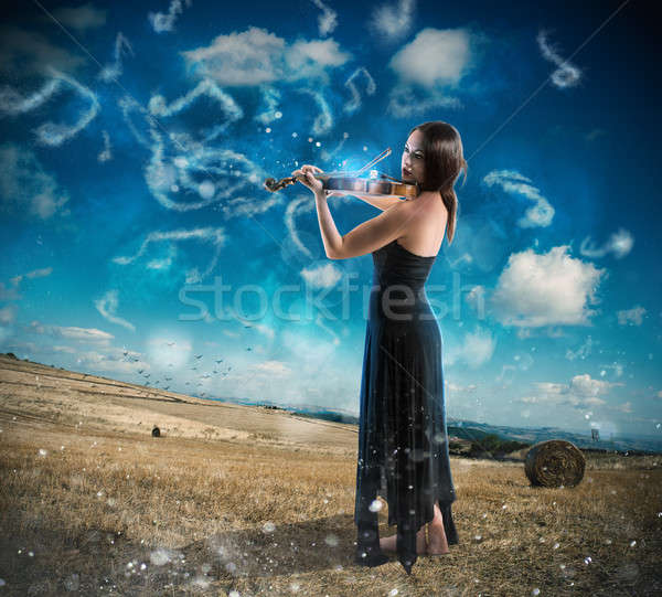 Charming violinist countryside Stock photo © alphaspirit