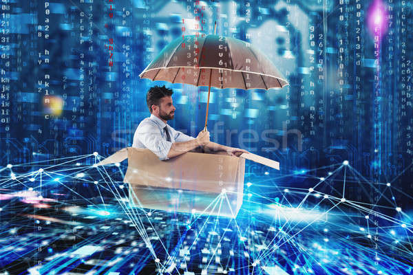 Businessman surfing the internet on a cardboard. Internet exploration concept Stock photo © alphaspirit