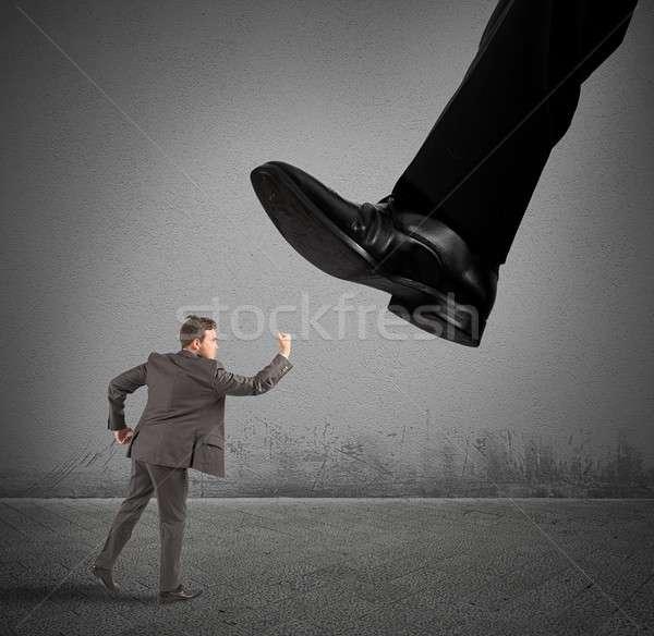 Businessman against boss Stock photo © alphaspirit