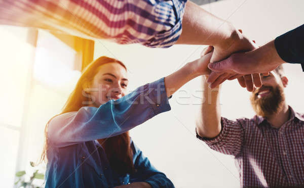 Business people putting their hands together. Concept of teamwork and partnership Stock photo © alphaspirit