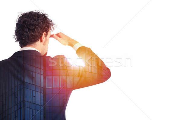 Businessman looks far for the future Stock photo © alphaspirit