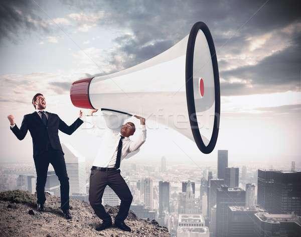 Poderoso discurso empresário megafone cidade Foto stock © alphaspirit