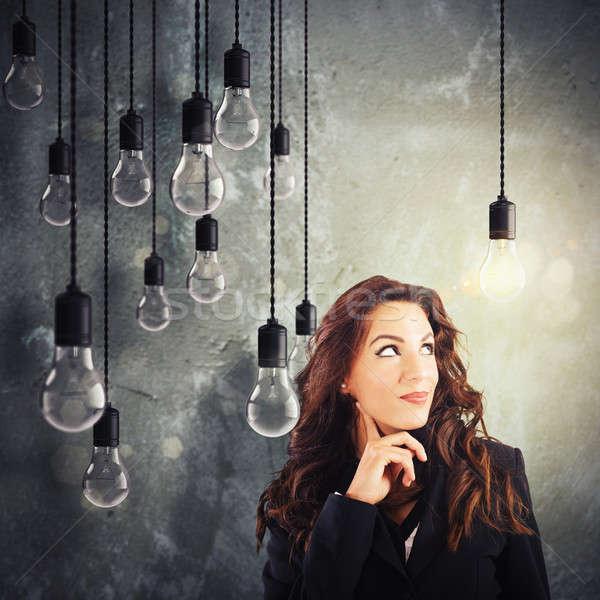 Zseniális ötlet sok ötletek nő villanykörte Stock fotó © alphaspirit