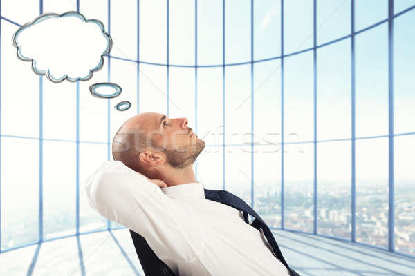 Successful Businessman relax and think Stock photo © alphaspirit
