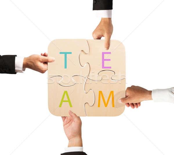 Business teamwork puzzle Stock photo © alphaspirit