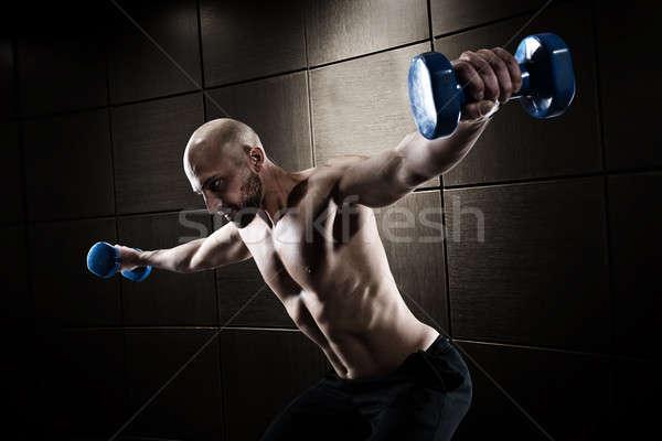 Hombre formación bíceps grunge muscular Foto stock © alphaspirit