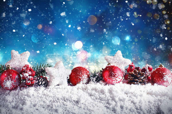 Christmas composition with balls, stars and garlands on snow Stock photo © alphaspirit