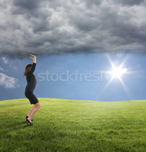 Business woman try to keep the summer instead of bad weather conditions Stock photo © alphaspirit