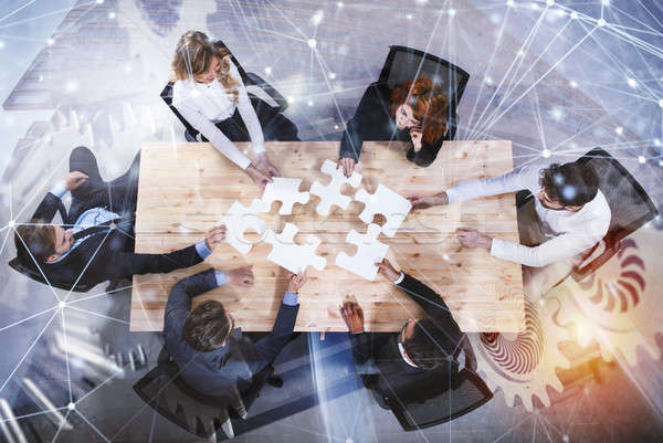 Travail d'équipe partenaires intégration démarrage pièces de puzzle engins Photo stock © alphaspirit