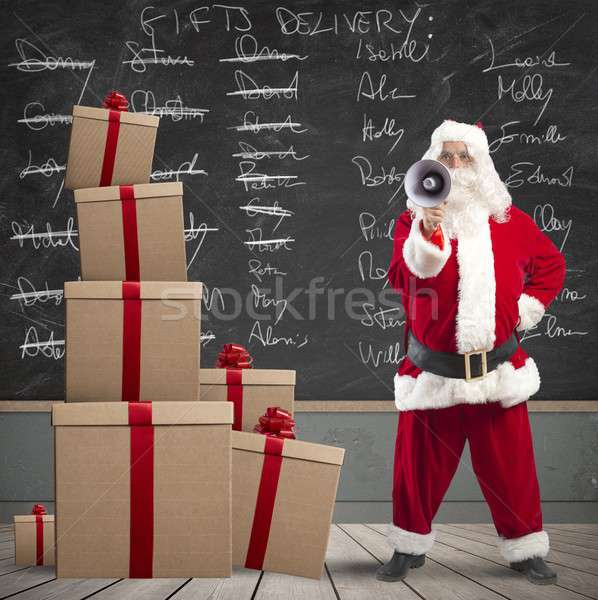 Santa Claus and list of gifts delivery Stock photo © alphaspirit