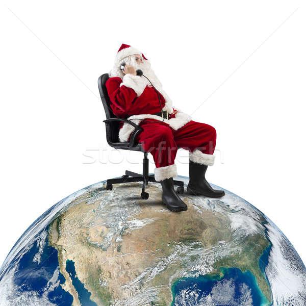 Noel baba telefon oturma sandalye büyük dünya Stok fotoğraf © alphaspirit
