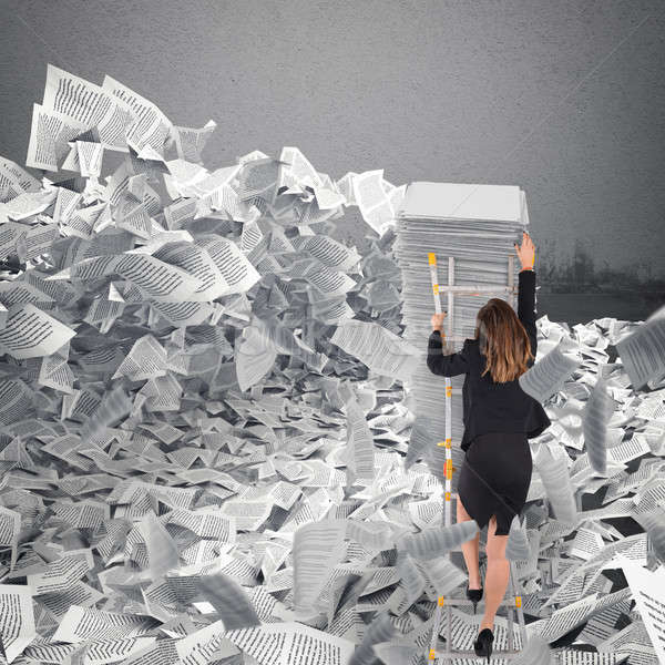 Businesswoman with paper sheet anywhere. Buried by bureaucracy concept. Stock photo © alphaspirit