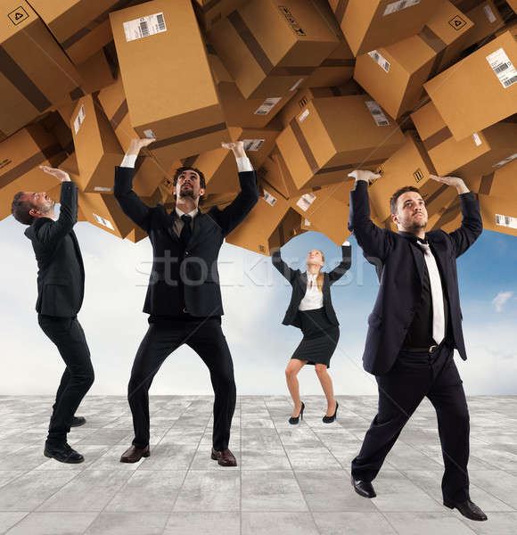 People buried by a stack of cardboard boxes. Concept of internet shopping addiction Stock photo © alphaspirit
