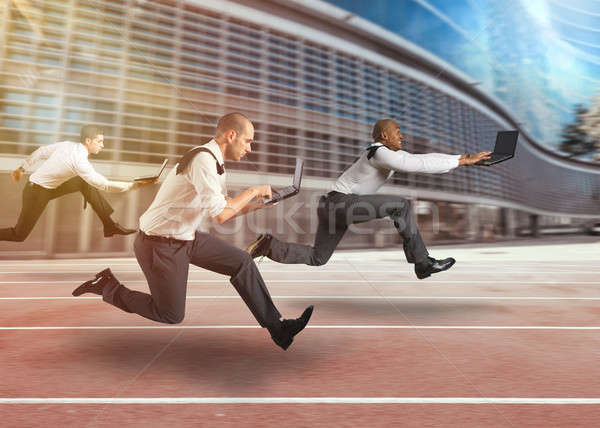 Business men working at full speed in a race track Stock photo © alphaspirit