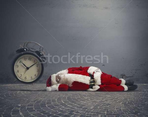 Święty mikołaj zmęczony zegar ulicy zimą Zdjęcia stock © alphaspirit