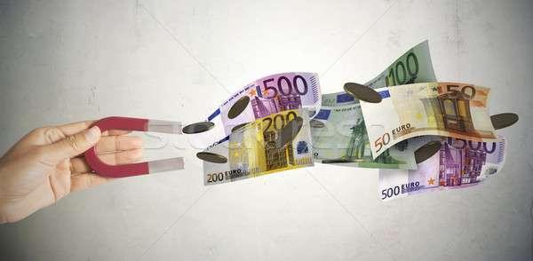 Magnete soldi molti finanziare mercato Foto d'archivio © alphaspirit