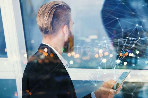 Okostelefon üzletember multimédia internet kapcsolat asztal Stock fotó © alphaspirit