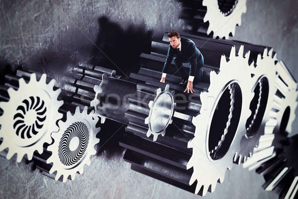 Man in a system of gear Stock photo © alphaspirit