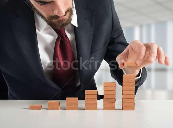 Financiële trappenhuis zakenman klein bakstenen business Stockfoto © alphaspirit