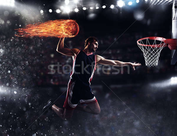 Basket player throws the fireball at the stadium Stock photo © alphaspirit