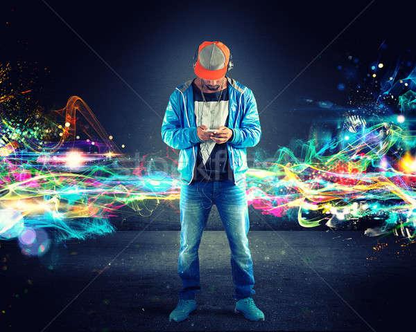 Erkek dinleme hip-hop müzik ışıklar etkileri Stok fotoğraf © alphaspirit