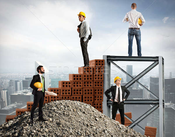 Businessmen work together to build a building Stock photo © alphaspirit