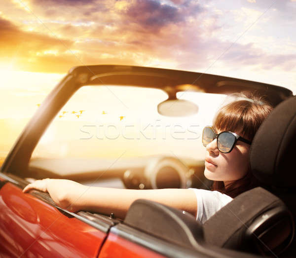 Young woman in cabriolet car near sea Stock photo © alphaspirit