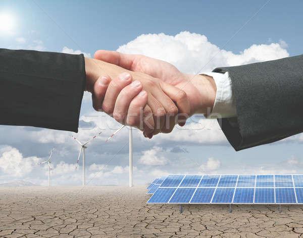 Renewable energy handhsake Stock photo © alphaspirit