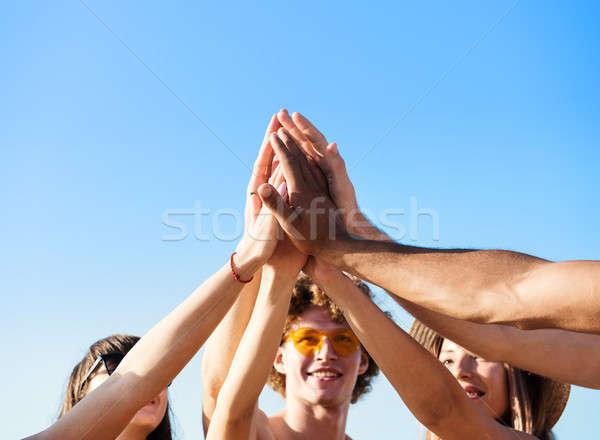 Group of friends having fun on the beach Stock photo © alphaspirit