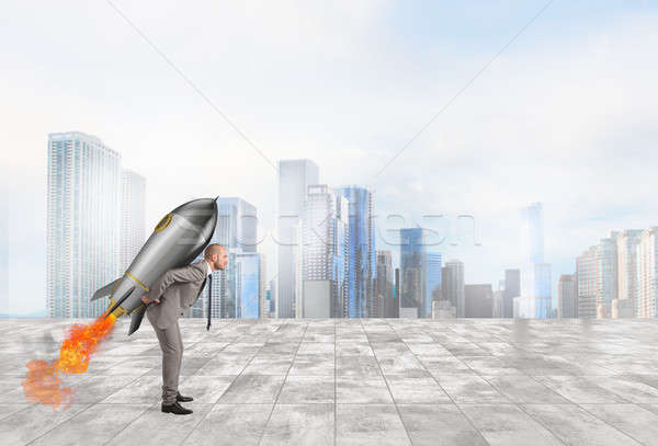 Determination and power businessman that holds a rocket Stock photo © alphaspirit