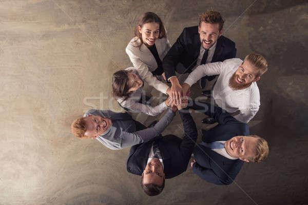 Gens d'affaires mains ensemble intégration travail d'équipe association Photo stock © alphaspirit