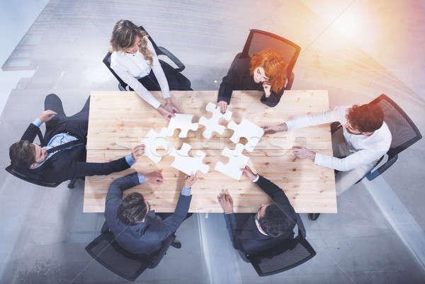 Trabalho em equipe parceria integração startup peças do puzzle dobrar Foto stock © alphaspirit
