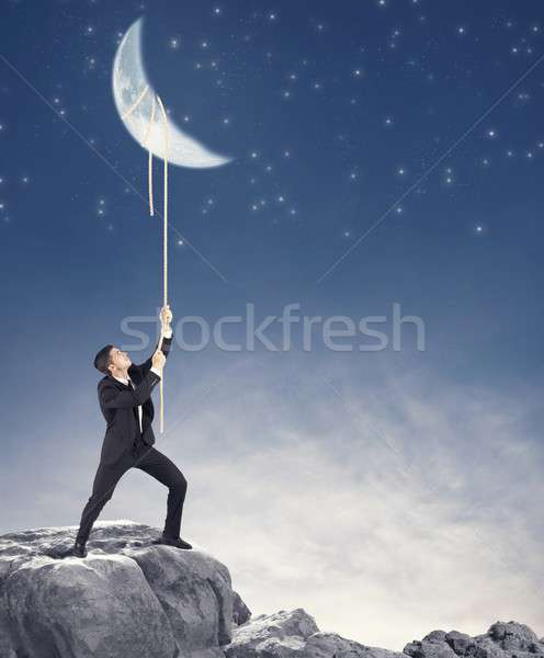 Businessman wants the moon Stock photo © alphaspirit