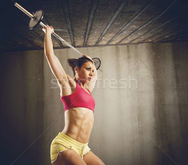 Hard workout with barbell Stock photo © alphaspirit