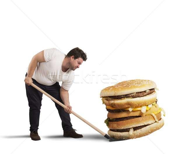 Elevador gigante sanduíche homem pá comida Foto stock © alphaspirit