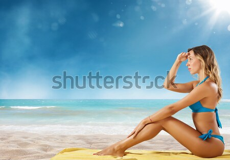 Sunbathe on the beach Stock photo © alphaspirit