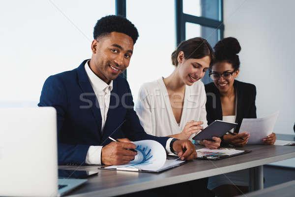 Csapat üzletember együtt csapatmunka emberek munka Stock fotó © alphaspirit