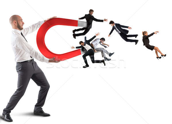 Businessman attracts people with a big magnet Stock photo © alphaspirit