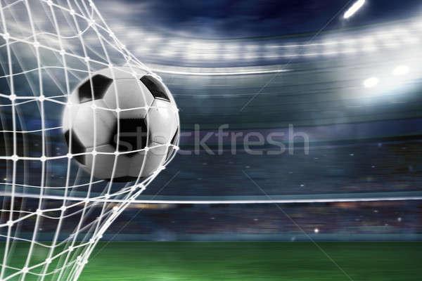 Soccer ball scores a goal on the net Stock photo © alphaspirit