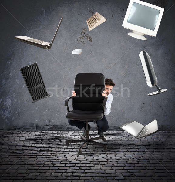 Businessman has fear of computers and technology Stock photo © alphaspirit
