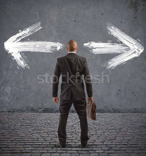 Confused businessman must choose the right way Stock photo © alphaspirit