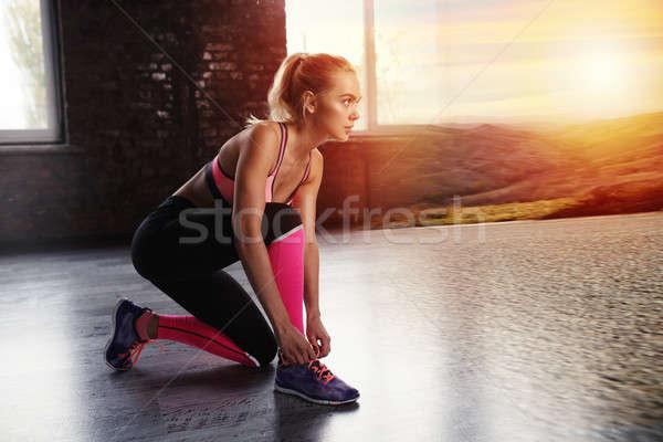 Blonde girl ready to run. Double exposure Stock photo © alphaspirit