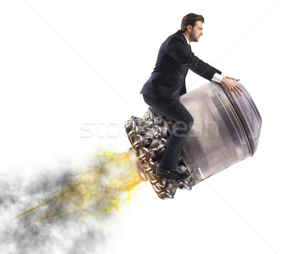 Businessman flying high Stock photo © alphaspirit