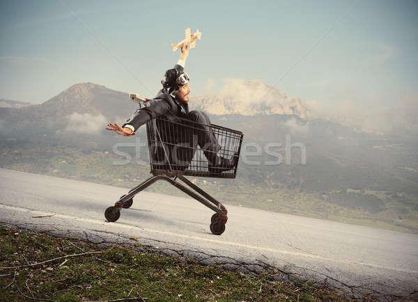 Crazy biznesmen jak dziecko drewna płaszczyzny Zdjęcia stock © alphaspirit
