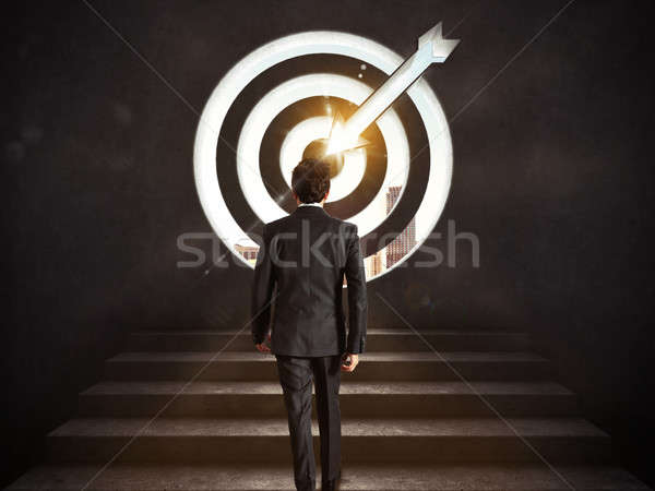 Arrive at a goal of success. Businessman climbing the stairs up to a target.. 3D Rendering Stock photo © alphaspirit