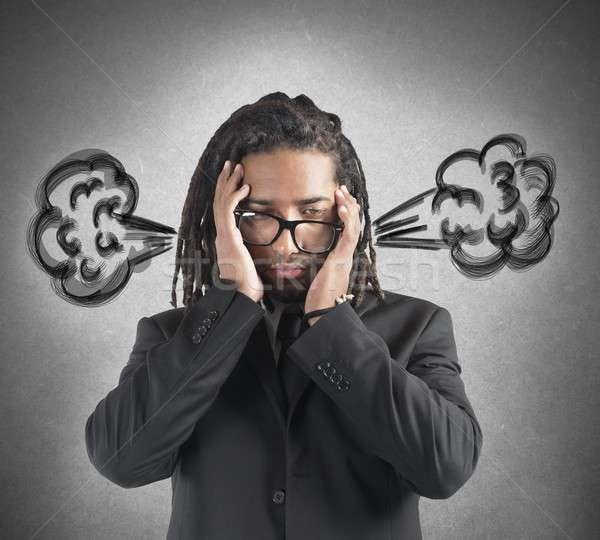 Businessman brain in smoke Stock photo © alphaspirit