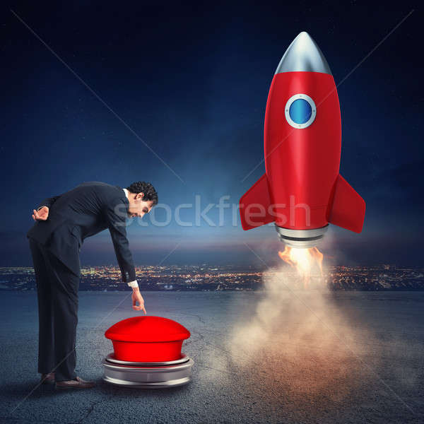 Businessman launches rocket pushing a red button. 3D Rendering Stock photo © alphaspirit