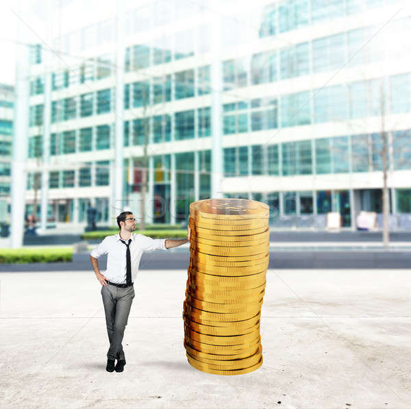 Successful businessman with a pile of money Stock photo © alphaspirit