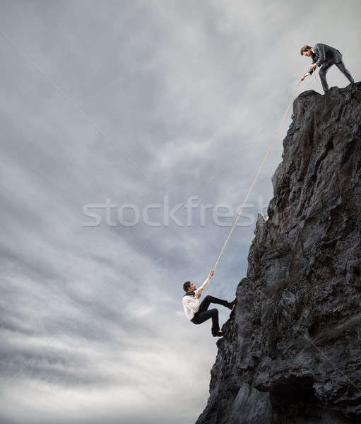Businessmen collaborate to achieve a goal Stock photo © alphaspirit